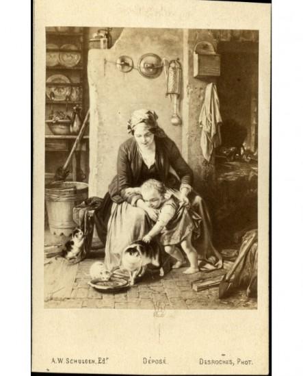 Peinture: femme et enfant, avec des chats, dans une cuisine paysanne