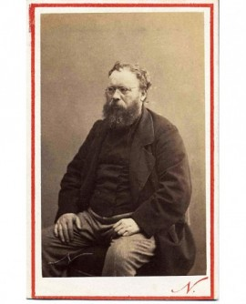 Portrait de Proudhon, assis, ébouriffé. Proudhon