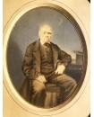 Homme posant assis. Photo peinte